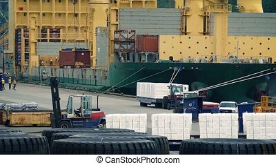 Busy Port With Workers Loading Ship - Workers loading crates...