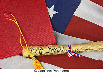 graduation hat on American flag - Red graduation cap and...