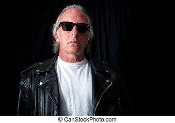 older grey haired biker - Imposing image of older biker...