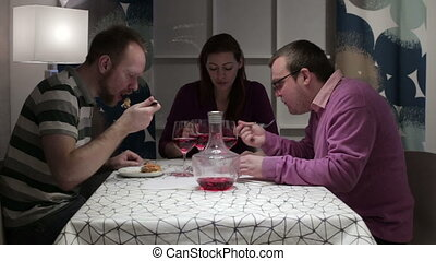Friends having dinner at the table - People sit at the...