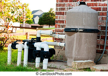 Pool pump equipment next to brick home. - Swimming pool pump...