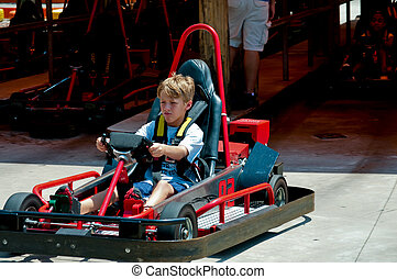 Cute little boy on red go cart. - Adorable young kid on a go...