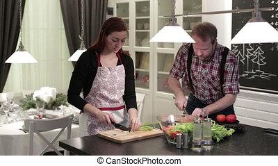 Woman and man preparing a salad