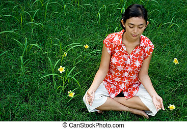ethnic woman meditate in nature
