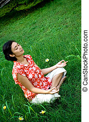 asian woman meditate in nature