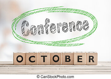 October conference sign made of wood on a stage