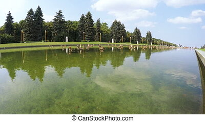 Pond with fountain in park - In city park pond with...