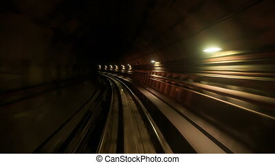 Camera Moves Backward along Metro Rails in Dark Tunnel