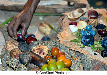 Yirrganydji Aboriginal woman hand assorting fruit and seeds...