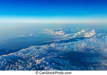 Big white cloud and blue sky background,view from airplane,...