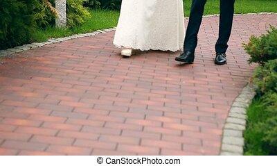 Image of bride and groom walking