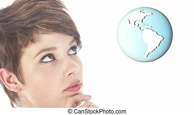 Young businesswoman looking at earth globe