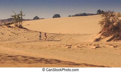 Guy Girl Walk around White Sand Dunes against Blue Sky -...