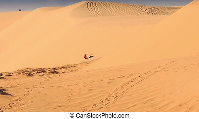 Tourist Tries Draw out Quad from Sand in Sand Dunes -...