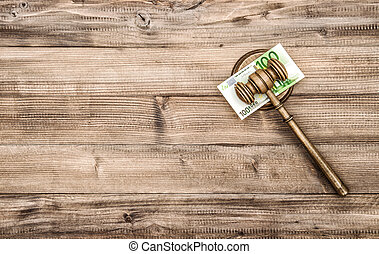 Judges Gavel with euro banknotes Auctioneer hammer on wooden...