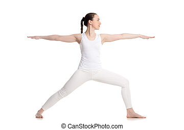 Yoga Warrior 2 Pose - Sporty beautiful young woman in white...