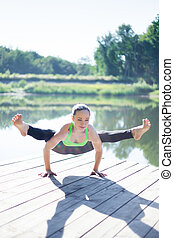 Firefly pose - Good looking sporty fit blond young woman in...