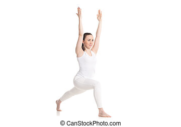 Yoga Virabhadra 1 Pose - Sporty beautiful young woman in...