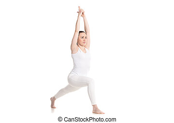 Yoga lunge exercise - Sporty beautiful young woman in white...