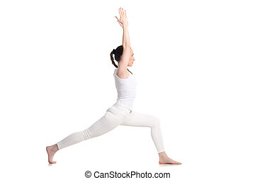 Yoga Warrior 1 Pose - Sporty beautiful young woman in white...