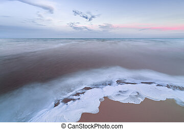 sea foam - Cloudy Picture slow shutter speed on the shore of...