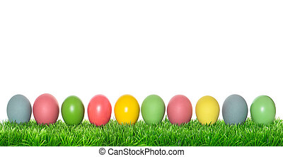 Easter eggs in green grass on white background