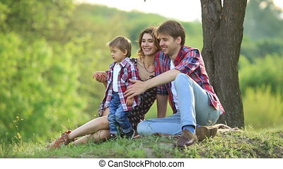 Happy family in a park on grass