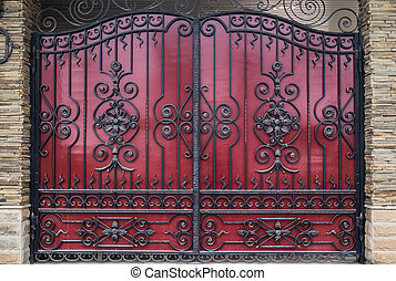 Iron gate with forged products for the background