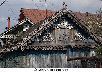 Wooden carving - Roof of the rural house ornated by a wooden...
