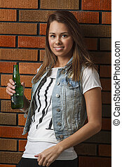 Beer holding - twenty something girl leaning against wall...