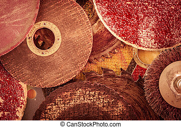 Old abrasive discs and hacksaw blade background. - Closeup...