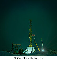 Drilling rig at night.