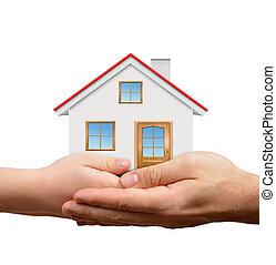 Child and male hands holding house