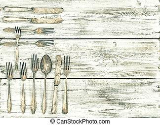 Antique cutlery wooden background kitchen utensils vintage -...
