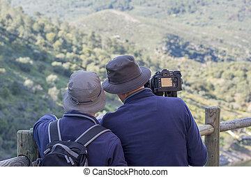 Wildlife Photographer - ornithologists couple watching and...