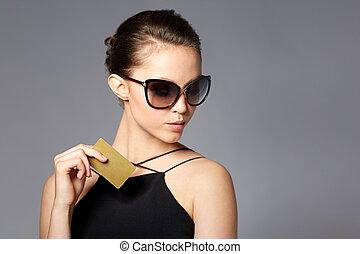 beautiful young woman in elegant black sunglasses -...