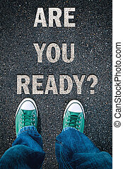 Are you ready - Brand new green shoes from above on asphalt...