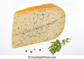 gouda with cumin in front of white background - Portion of...