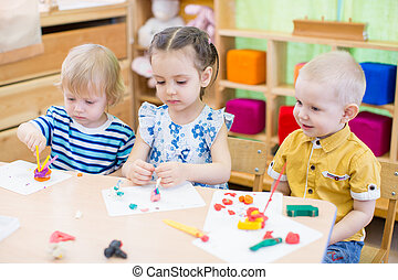 kids learning arts and crafts in kindergarten - kids group...