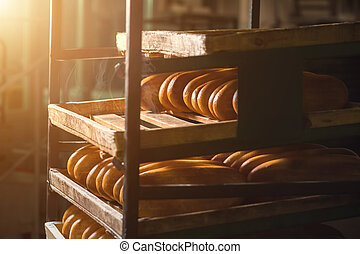 Long yellow loaves of bread. Bread laying on shelves. Fresh...