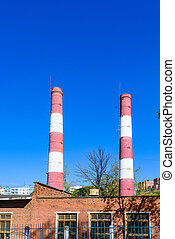 brick chimneys, hot water boiler - Factory pipe produces...