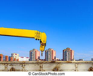 yellow crane arm with a sliding boom hook mechanism
