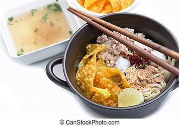 Spicy lemongrass flavored flat noodles with pork , Asian...