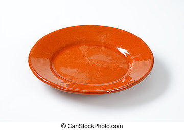 glazed ceramic plate on white background