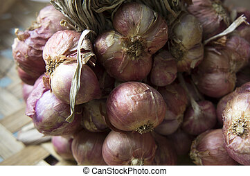 red onion batch unpeeled pile purple concept - red onion...