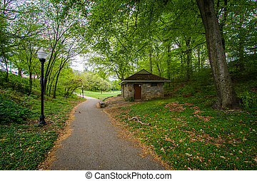 Walkway at Wyman Park Dell, in Baltimore, Maryland. -...