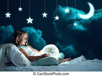 Girl in her bed and glowing globe - Cute girl sitting in bed...