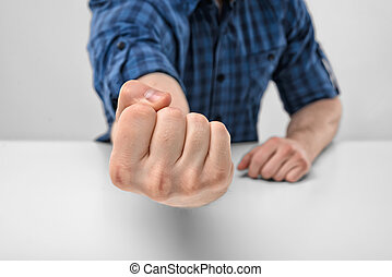 Close-up hand of man shows clenched fist Body language Hand...