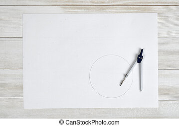 Engineering divider on a white paper.