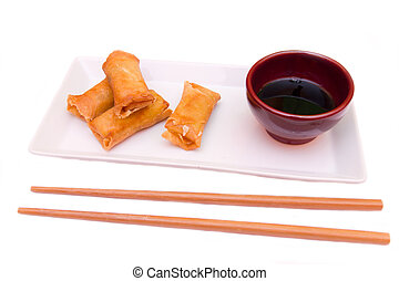 Tray with spring rolls on a white background